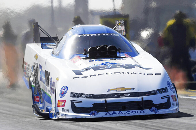 In this photo Oct. 19, 2019, file photo, provided by the NHRA, John Force drives in Funny Car during qualifying for the AAA Texas NHRA Fall Nationals drag races in Ennis, Texas. More than a half century after he began piloting dragsters, Force, 70, will be in his Funny Car this weekend for the start of a new season in Pomona, Calif. (Jerry Foss/NHRA via AP, File)