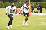 Philadelphia Eagles safety Jalen Mills, left, warms up with cornerback Darius Slay, right, during an NFL football practice, Thursday, Sept. 24, 2020, in Philadelphia. (AP Photo/Chris Szagola, Pool)