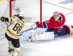Montreal Canadiens goaltender Carey Price (31) stops Boston Bruins right wing David Pastrnak (88) during second period NHL hockey action in Montreal, Monday, Dec. 17, 2018. (Ryan Remiorz/The Canadian Press via AP)
