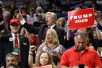 A Donald Trump impersonator cheers before President Donald Trump arrives to speak at his re-election kickoff rally at the Amway Center, Tuesday, June 18, 2019, in Orlando, Fla. (AP Photo/Evan Vucci)