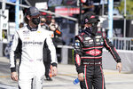 Corey LaJoie, left, and Austin Dillon walks down pit road before the start of the NASCAR Cup Series road-course auto race at Daytona International Speedway, Sunday, Feb. 21, 2021, in Daytona Beach, Fla. (AP Photo/John Raoux)