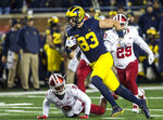 Michigan tight end Zach Gentry (83) rushes past Indiana defensive back Jonathan Crawford (9) after making a 42-yard reception in the second quarter of an NCAA college football game in Ann Arbor, Mich., Saturday, Nov. 17, 2018. (AP Photo/Tony Ding)