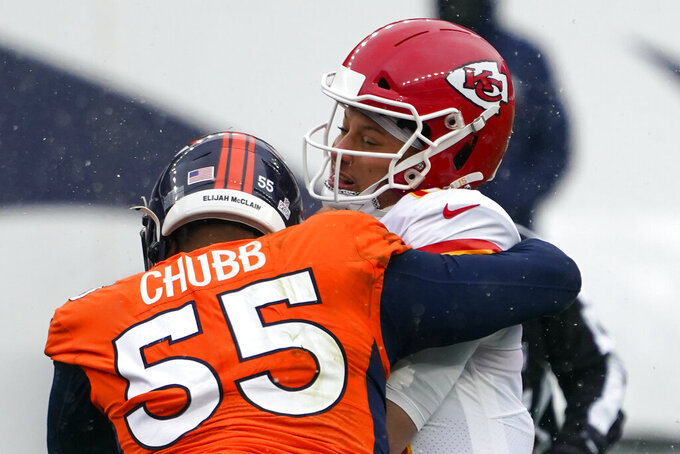 Kansas City Chiefs quarterback Patrick Mahomes, right, is hit by Denver Broncos outside linebacker Bradley Chubb (55) as he throws a pass during the first half of an NFL football game Sunday, Oct. 25, 2020, in Denver. (AP Photo/Jack Dempsey)