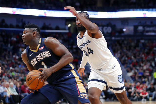 New Orleans Pelicans forward Zion Williamson (1) make a move to the basket next to Memphis Grizzlies forward Solomon Hill (44) during the first half of an NBA basketball game in New Orleans, Friday, Jan. 31, 2020. (AP Photo/Gerald Herbert)