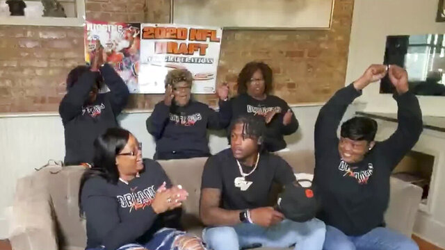 In this still image from video provided by the NFL, Tee Higgins, front center, is selected by the Cincinnati Bengals in the second round of the NFL football draft, Friday, April 24, 2020. (NFL via AP)