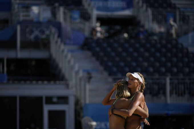 Margareta Kozuch, of Germany, right, and teammate Laura Ludwig react during a women's beach volleyball match against Switzerland at the 2020 Summer Olympics, Saturday, July 24, 2021, in Tokyo, Japan. (AP Photo/Felipe Dana)