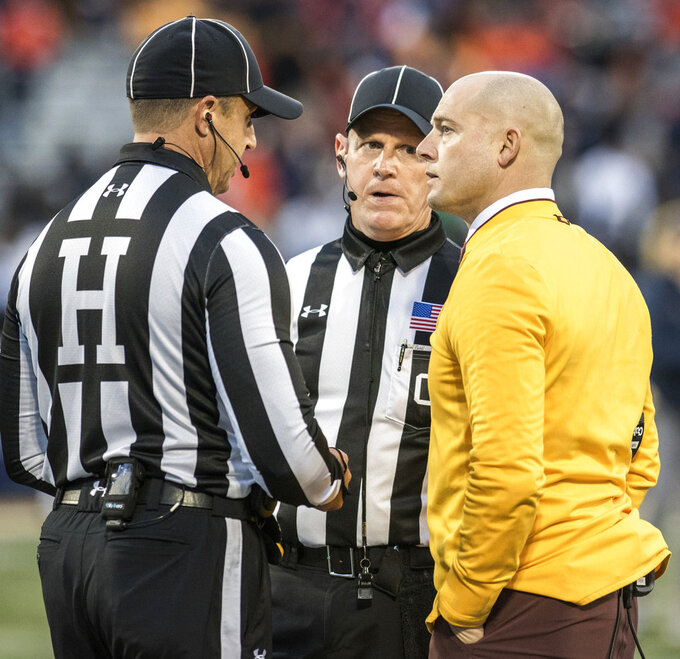 Minnesota head coach P.J. Fleck has a serious conversation with officials in the second half of a NCAA college football game against Illinois Saturday, Nov. 3, 2018, in Champaign, Ill. (AP Photo/Holly Hart)