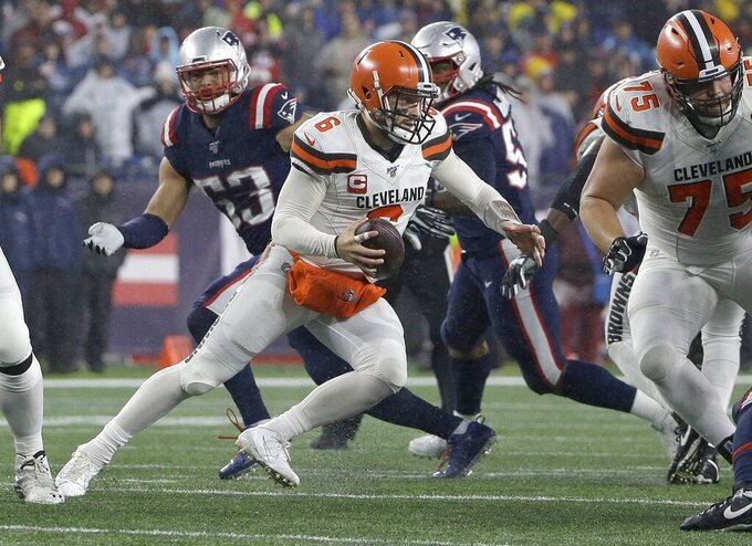 Cleveland Browns quarterback Baker Mayfield scrambles against the New England Patriots in the second half of an NFL football game, Sunday, Oct. 27, 2019, in Foxborough, Mass. (AP Photo/Steven Senne)
