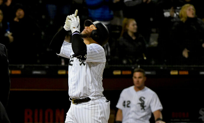 Chicago White Sox's Welington Castillo reacts after hitting a two-run home run during the eighth inning of a baseball game against the Kansas City Royals, Monday, April 15, 2019, in Chicago. (AP Photo/Matt Marton)