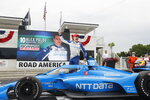 Alex Palou celebrates his victory in an IndyCar race at Road America in Elkhart Lake, Wisc., Sunday, June 20, 2021. (AP Photo/Jeffrey Phelps)
