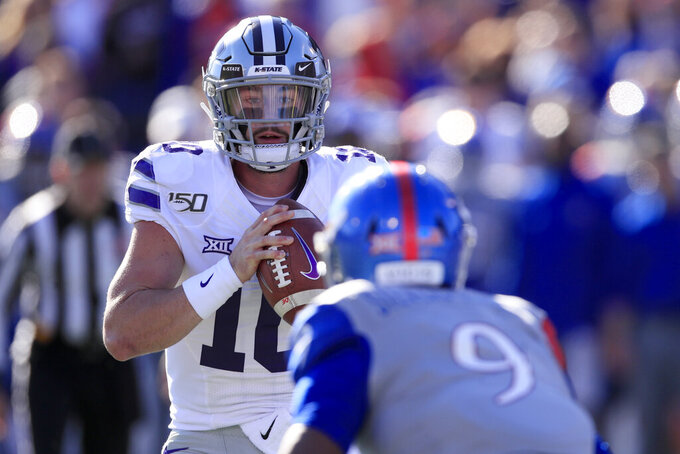 Kansas State quarterback Skylar Thompson (10) stares down Kansas linebacker Najee Stevens-McKenzie (9) before pitching the ball during the first half of an NCAA college football game in Lawrence, Kan., Saturday, Nov. 2, 2019. (AP Photo/Orlin Wagner)