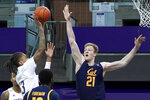 California forward Lars Thiemann (21) tries to block a shot by Washington forward Hameir Wright, left, during the first half of an NCAA college basketball game, Saturday, Feb. 20, 2021, in Seattle. (AP Photo/Ted S. Warren)