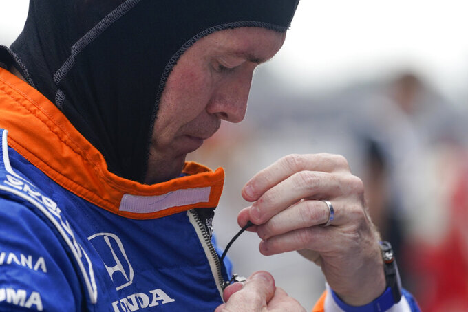 Scott Dixon, of New Zealand, prepares to drive during a practice session for the IndyCar auto race at Indianapolis Motor Speedway, Friday, Aug. 13, 2021, in Indianapolis. (AP Photo/Darron Cummings)