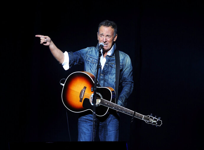 """FILE - In this Nov. 5, 2018 file photo, Bruce Springsteen performs at the 12th annual Stand Up For Heroes benefit concert at the Hulu Theater at Madison Square Garden in New York. Springsteen's new studio release """"Western Stars"""" breaks fresh ground for the veteran rocker, who turns his back not only on the blistering sound of the E Street Band but also abandons the haunting acoustic moods pioneered on """"Nebraska"""" and fine-tuned on later solo efforts.  (Photo by Brad Barket/Invision/AP, File)"""
