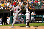 Los Angeles Angels' Shohei Ohtani, of Japan, left, scores on a one-run single by Jared Walsh as Chicago White Sox catcher Zack Collins looks to the field during the fifth inning of a baseball game in Chicago, Thursday, Sept. 16, 2021. (AP Photo/Nam Y. Huh)