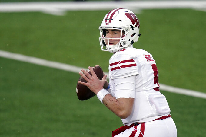 FILE - In this Dec. 12, 2020, file photo, Wisconsin quarterback Graham Mertz throws a pass during an NCAA college football game against Iowa in Iowa City, Iowa. Wisconsin faces Penn State on Saturday as they open their college football season.(AP Photo/Charlie Neibergall, File)