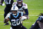 Carolina Panthers running back Mike Davis scores against the Denver Broncos during the second half of an NFL football game Sunday, Dec. 13, 2020, in Charlotte, N.C. (AP Photo/Gerry Broome)