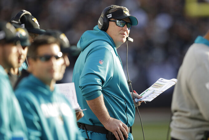 Jacksonville Jaguars head coach Doug Marrone stands on the sideline during the second half of an NFL football game against the Oakland Raiders in Oakland, Calif., Sunday, Dec. 15, 2019. (AP Photo/Ben Margot)