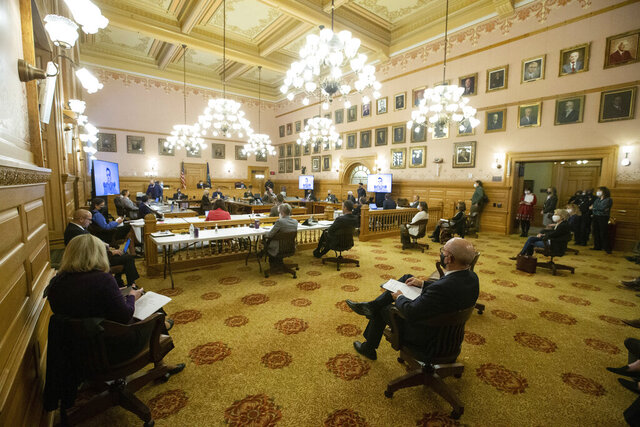 Proponents and opponents for the Kansas constitutional amendment change to abortion sit socially distanced in the Federal and State Affairs committee meeting Friday, Jan. 15, 2021 at the Statehouse in Topeka, Kansas. (Evert Nelson/The Topeka Capital-Journal via AP)