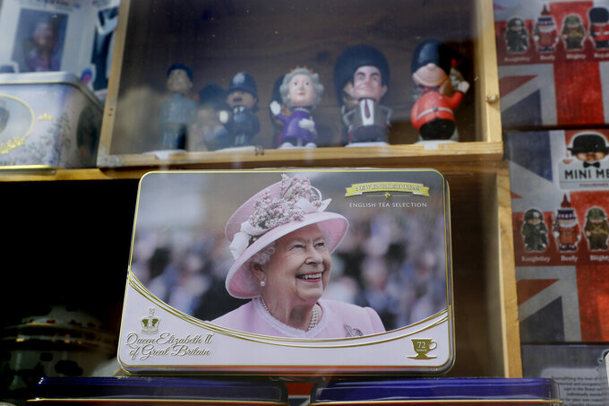 A souvenir shop selling memorabilia with pictures of Queen Elizbeth II, in Windsor, England Wednesday, April 21, 2021. Britain's Queen Elizabeth II is marking her 95th birthday in a low-key fashion at Windsor Castle, just days after the funeral of her husband Prince Philip. Some members of the royal family are expected to be with the queen on Wednesday. Her birthday falls within the two-week royal mourning period for Philip that is being observed until Friday. (AP Photo/Kirsty Wigglesworth)