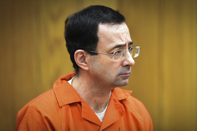 FILE - In this Feb. 5, 2018, file photo, Larry Nassar, former sports doctor who admitted molesting some of the nation's top gymnasts, appears in Eaton County Court in Charlotte, Mich. A judge dismissed criminal charges Wednesday May 13, 2020 against former Michigan State University President Lou Anna Simon arising from Nassar's sexual assault scandal. Simon was ordered to trial last year on charges that she lied to police about her knowledge of a sexual misconduct complaint against Nassar, who was a campus doctor and now is serving decades in prison. (Matthew Dae Smith/Lansing State Journal via AP, File)