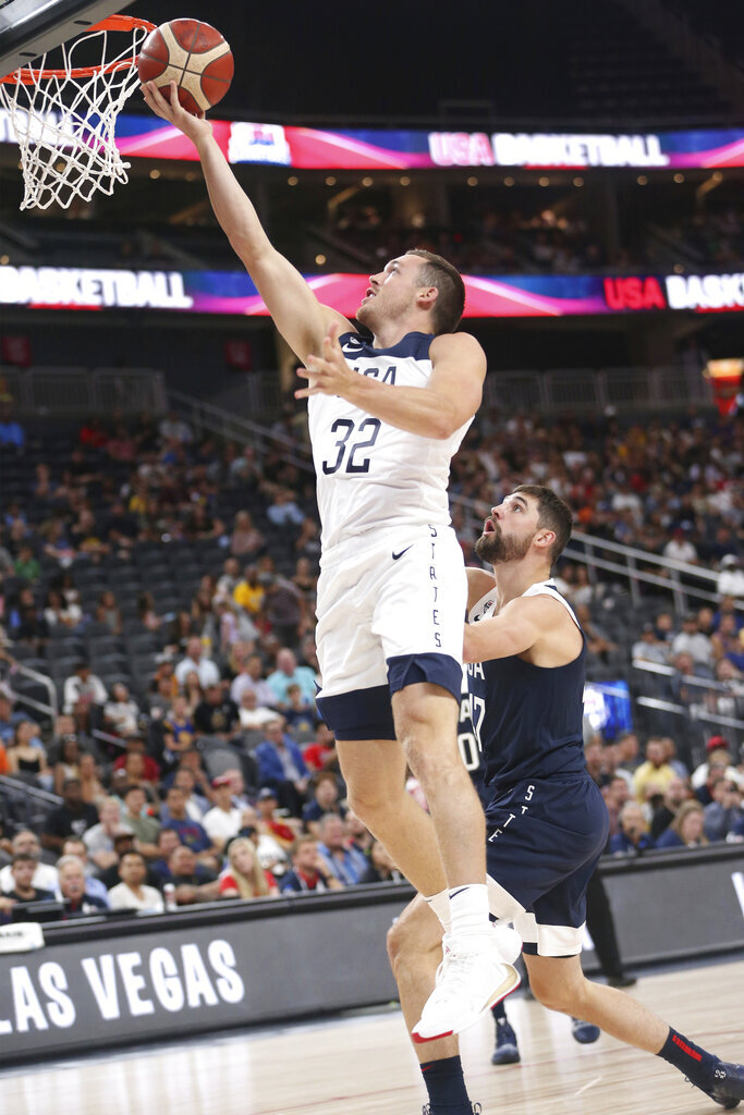 Team White guard Pat Connaughton (32) goes up for a shot against pressure from Team Blue guard Joe Harris (47) during the first half of the U.S. men's basketball team's scrimmage in Las Vegas, Friday, Aug. 9, 2019. (Erik Verduzco/Las Vegas Review-Journal via AP)