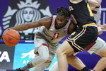 Stanford guard Daejon Davis, left, collides with Washington guard Erik Stevenson during the second half of an NCAA college basketball game Thursday, Feb. 18, 2021, in Seattle. (AP Photo/Ted S. Warren)