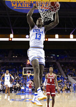 UCLA guard Kris Wilkes dunks as Stanford forward KZ Okpala watches during the first half of an NCAA college basketball game Thursday, Jan. 3, 2019, in Los Angeles. (AP Photo/Mark J. Terrill)
