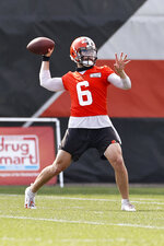 Cleveland Browns quarterback Baker Mayfield throws a pass during practice at the NFL football team's training facility Friday, Aug. 14, 2020, in Berea, Ohio. (AP Photo/Ron Schwane)