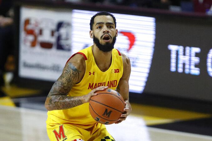 Maryland guard Eric Ayala prepares to shoot a 3-point shot against Nebraska during the first half of an NCAA college basketball game, Tuesday, Feb. 11, 2020, in College Park, Md. (AP Photo/Julio Cortez)
