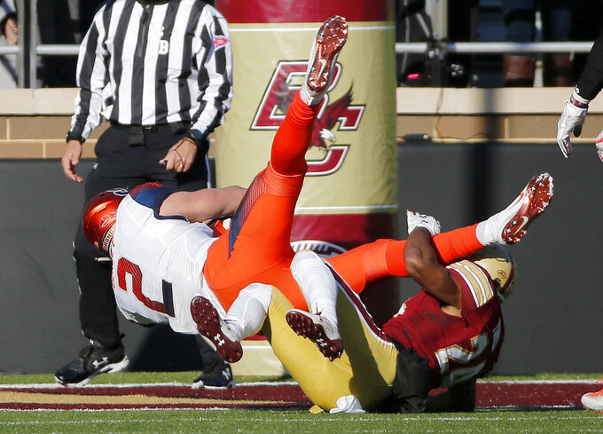Syracuse quarterback Eric Dungey (2) is upended in the end zone as he scores a rushing touchdown over Boston College defensive back Taj-Amir Torres (24) during the first half of an NCAA college football game, Saturday, Nov. 24, 2018, in Boston. (AP Photo/Mary Schwalm)
