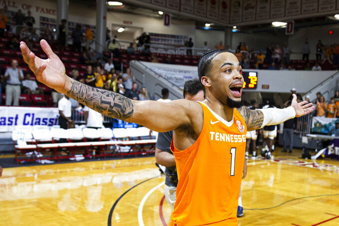 Tennessee guard Lamonte Turner (1) reacts to hitting the winning shot at the buzzer in the Emerald Coast Classic against Virginia Commonwealth in Niceville, Fla., Saturday, Nov. 30, 2019. Tennessee won 72-69. (AP Photo/Mark Wallheiser)
