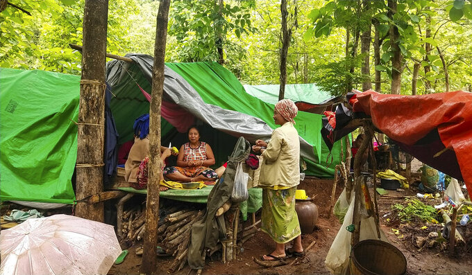Internally displaced women talk at their makeshift tents at Pu Phar Village, Demawso Township, Kayah State on Thursday, June 17, 2021. A report on the situation in conflict-affected areas of Myanmar issued this week by the U.N.'s Office for the Coordination of Humanitarian Affairs says around 108,800 people from Kayah State were internally displaced following an escalation of hostilities between the government military and the local Karenni People's Defense Force militia since the coup Feb. 1, 2021. (AP Photo)