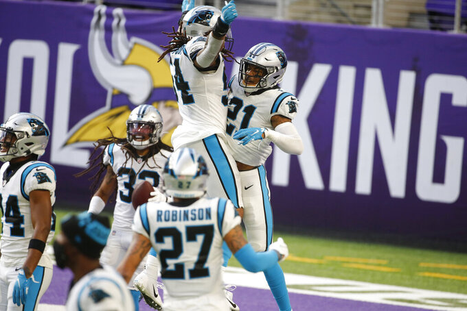 Carolina Panthers safety Jeremy Chinn (21) celebrates with teammates after returning a fumble 28-yards for a touchdown during the second half of an NFL football game against the Minnesota Vikings, Sunday, Nov. 29, 2020, in Minneapolis. (AP Photo/Bruce Kluckhohn)