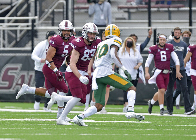Southern Illinois running back Justin Strong (5) looks for a block from wide receiver Branson Combs (83) against North Dakota State free safety Dom Jones (10) during the second quarter of an NCAA college football game Saturday, Feb. 29, 2021, in Carbondale, Ill. (Byron Hetzler/The Southern Illinoisan via AP)