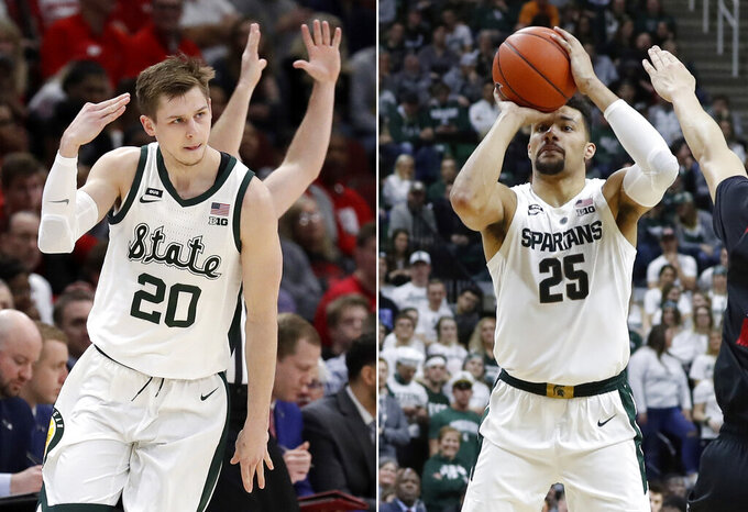 FILE - At left, in a March 16, 2019, file photo, Michigan State's Matt McQuaid (20) reacts after shooting a 3-point basket during the first half of an NCAA college basketball game against Wisconsin in the semifinals of the Big Ten Conference tournament, in Chicago. At right, in a Feb. 20, 2019, file photo, Michigan State forward Kenny Goins shoots during the second half of an NCAA college basketball game, in East Lansing, Mich. Big Ten champion Michigan State is seeded second in the NCAA Tournament in part because seniors Matt McQuaid and Kenny Goins have gone from being role players to standouts.(AP Photo/File)