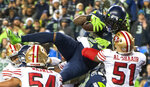 Seattle Seahawks running back Marshawn Lynch leaps over the pile to score a touchdown in the fourth quarter of an NFL football game in Seattle on Sunday, Dec. 29, 2019. (Drew Perine/The News Tribune via AP)