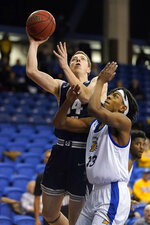 CORRECTS DAY OF WEEK - Utah State forward Justin Bean (34) drives to the basket against San Jose State guard Seneca Knight (13) during the first half of an NCAA college basketball game Wednesday, Dec. 4, 2019, in San Jose, Calif. (AP Photo/Tony Avelar)