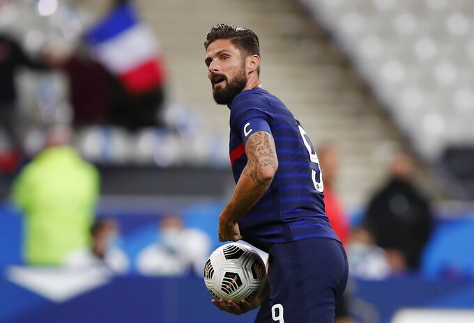 France's Olivier Giroud celebrates after scoring his side's second goal during their friendly international soccer match between France and Ukraine at the Stade deFrance in Saint Denis, north of Paris, Wednesday Oct. 7, 2020. (AP Photo/Francois Mori)