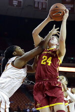 FILE - In this March 2, 2019, file photo, Iowa State guard Ashley Joens (24) is fouled by Texas forward Jatarie White as she shoots during the second half of an NCAA college basketball game in Austin, Texas. When Ashley Joens squared off with her sisters in basketball, one ground rule existed. No fouls. The future Iowa State star and her four talented siblings would simply compete — no holds barred — as their father, Brian, looked on. There was a method to the mayhem — and it's evident in Joens' hard-nosed approach to the game. (AP Photo/Eric Gay, File)