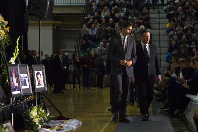Canadian Prime Minister Justin Trudeau, left, arrives with Alberta Premier Jason Kenney during a memorial for the victims of the Ukrainian plane disaster in Iran this past week in Edmonton, Alberta, Sunday, Jan. 12, 2020. (Todd Korol/The Canadian Press via AP)