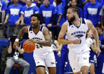Nevada forward Jordan Caroline, back, picks up a loose ball and trails forward Caleb Martin down the court against Air Force during the first half of an NCAA college basketball game Tuesday, March 5, 2019, at Air force Academy, Colo.(AP Photo/David Zalubowski)