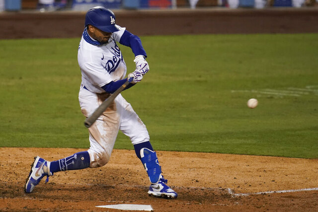 Los Angeles Dodgers' Mookie Betts connects for a solo home run during the ninth inning of the team's baseball game against the Arizona Diamondbacks on Wednesday, Sept. 2, 2020, in Los Angeles. (AP Photo/Marcio Jose Sanchez)