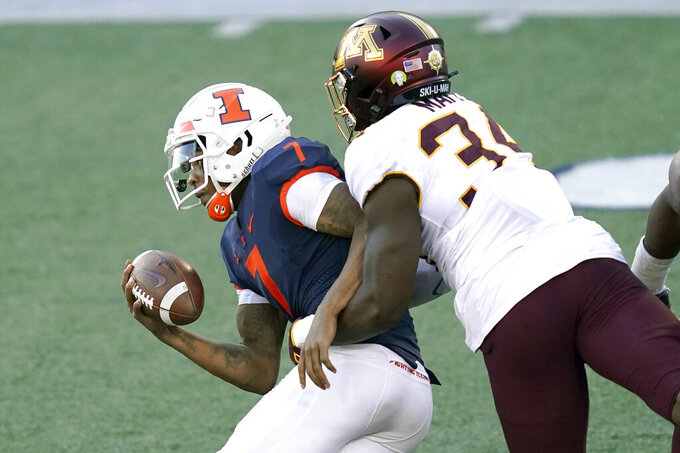 Minnesota defensive lineman Boye Mafe (34) sacks Illinois quarterback Coran Taylor during the first half of an NCAA college football game Saturday, Nov. 7, 2020, in Champaign, Ill. (AP Photo/Charles Rex Arbogast)