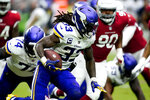 Minnesota Vikings running back Dalvin Cook (33) runs the ball against the Arizona Cardinals during the first half of an NFL football game, Sunday, Sept. 19, 2021, in Glendale, Ariz. (AP Photo/Ross D. Franklin)