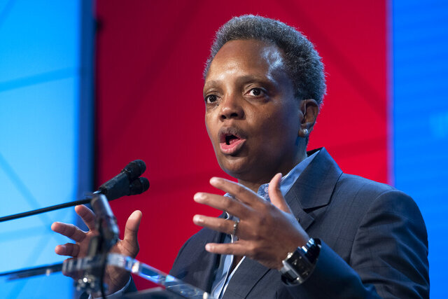 FILE - In this Jan. 23, 2020, file photo, Chicago Mayor Lori Lightfoot, speaks at the U.S. Conference of Mayors' Winter Meeting in Washington. Underprivileged areas in Chicago will receive an estimated $20 million investment for revitalization efforts that prioritize affordable housing and economic development, Lightfoot and Illinois Gov. J.B. Pritzker announced Monday, Jan. 27. (AP Photo/Cliff Owen, File)