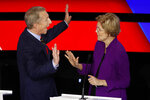 Democratic presidential candidates businessman Tom Steyer, left and Sen. Elizabeth Warren, D-Mass., talk during a break Tuesday, Jan. 14, 2020, during a Democratic presidential primary debate hosted by CNN and the Des Moines Register in Des Moines, Iowa. (AP Photo/Patrick Semansky)