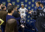 Notre Dame's Arike Ogunbowale talks to reporters during the university's NCAA college basketball media day, Thursday, Oct. 11, 2018, in South Bend, Ind. (Robert Franklin/South Bend Tribune via AP)