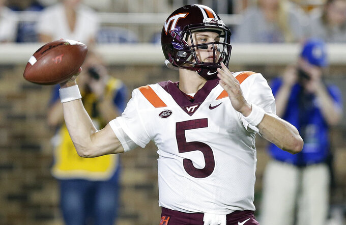 FILE - In this Sept. 29, 2018, file photo, Virginia Tech quarterback Ryan Willis (5) passes during the first half of an NCAA college football game against Duke, in Durham, N.C.  Midway through this season, a mid-November 2018 matchup between longtime rivals Miami and Virginia Tech seemed likely to have major implications in the ACC's Coastal Division race, if not nationally.  Both teams would love for that still to be the case.   (AP Photo/Gerry Broome, File)