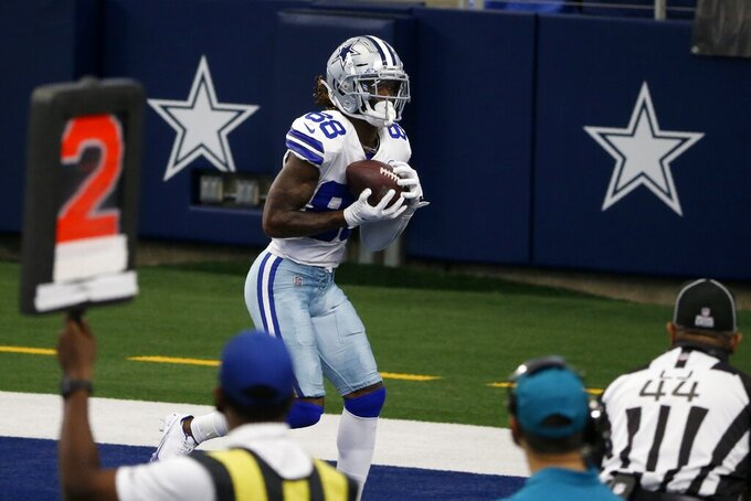 Dallas Cowboys wide receiver CeeDee Lamb (88) catches a touchdown pass as umpire Jeff Rice (44) looks on in the second half of an NFL football game against the Cleveland Browns in Arlington, Texas, Sunday, Oct. 4, 2020. (AP Photo/Michael Ainsworth)